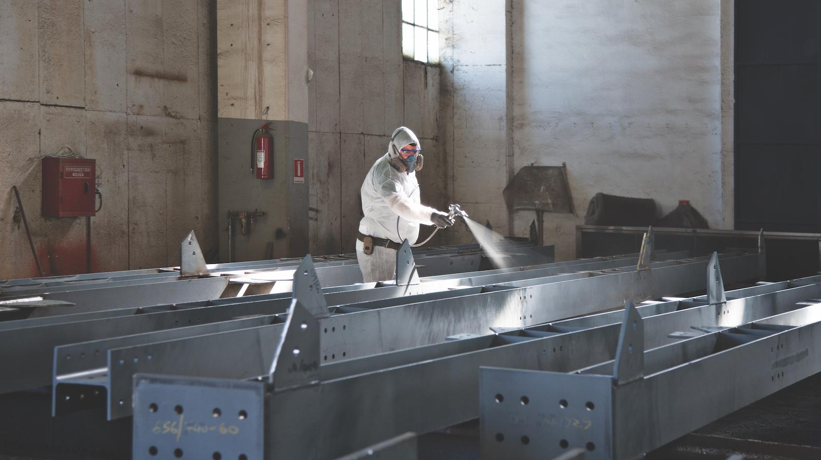 Factory application of intumescent paint. Photo credit: Hempel