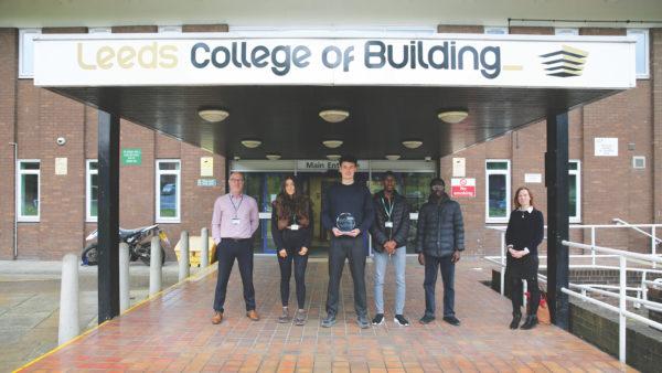 Leeds College of Building's winning team receive their trophy